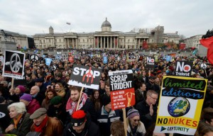 Protesters gather during an anti Trident rally, in Trafalgar Square, London, Saturday Feb. 27, 2016. Thousands have marched through London to oppose the renewal of Britain's Trident nuclear weapons system in what demonstrators describe as the biggest such rally in a generation. (Anthony Devlin/PA via AP) UNITED KINGDOM OUT NO SALES NO ARCHIVE